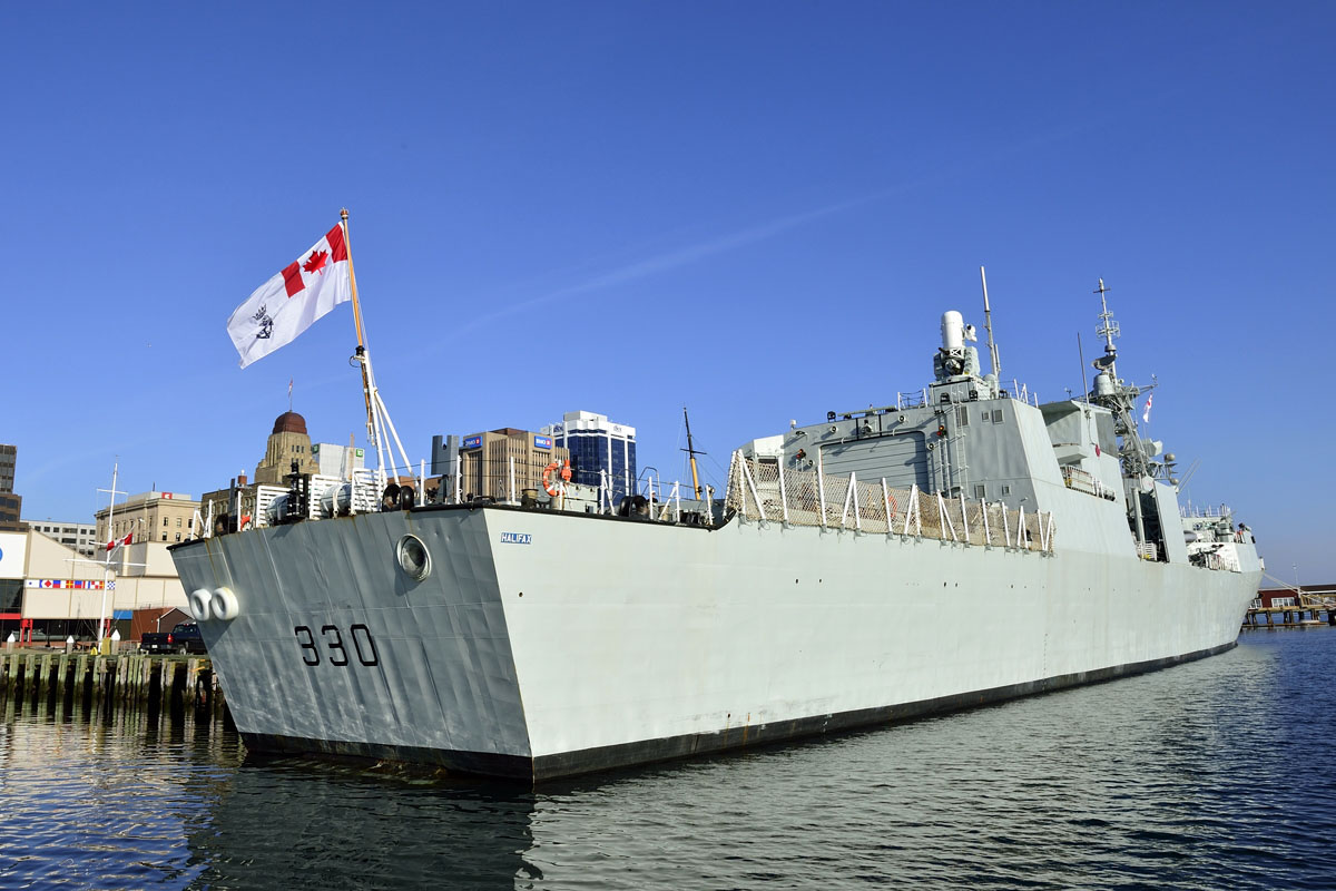HMCS Halifax flies the new Canadian Naval Ensign for the first time